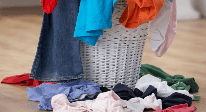laundry basket with overflowing pile of clothes