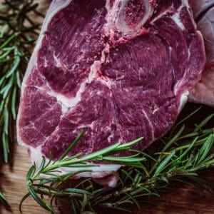 raw steak with fresh rosemary