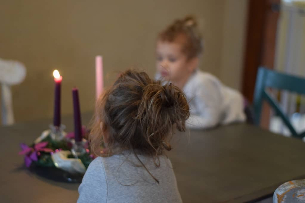 two little girls admiring the completed advent wreath