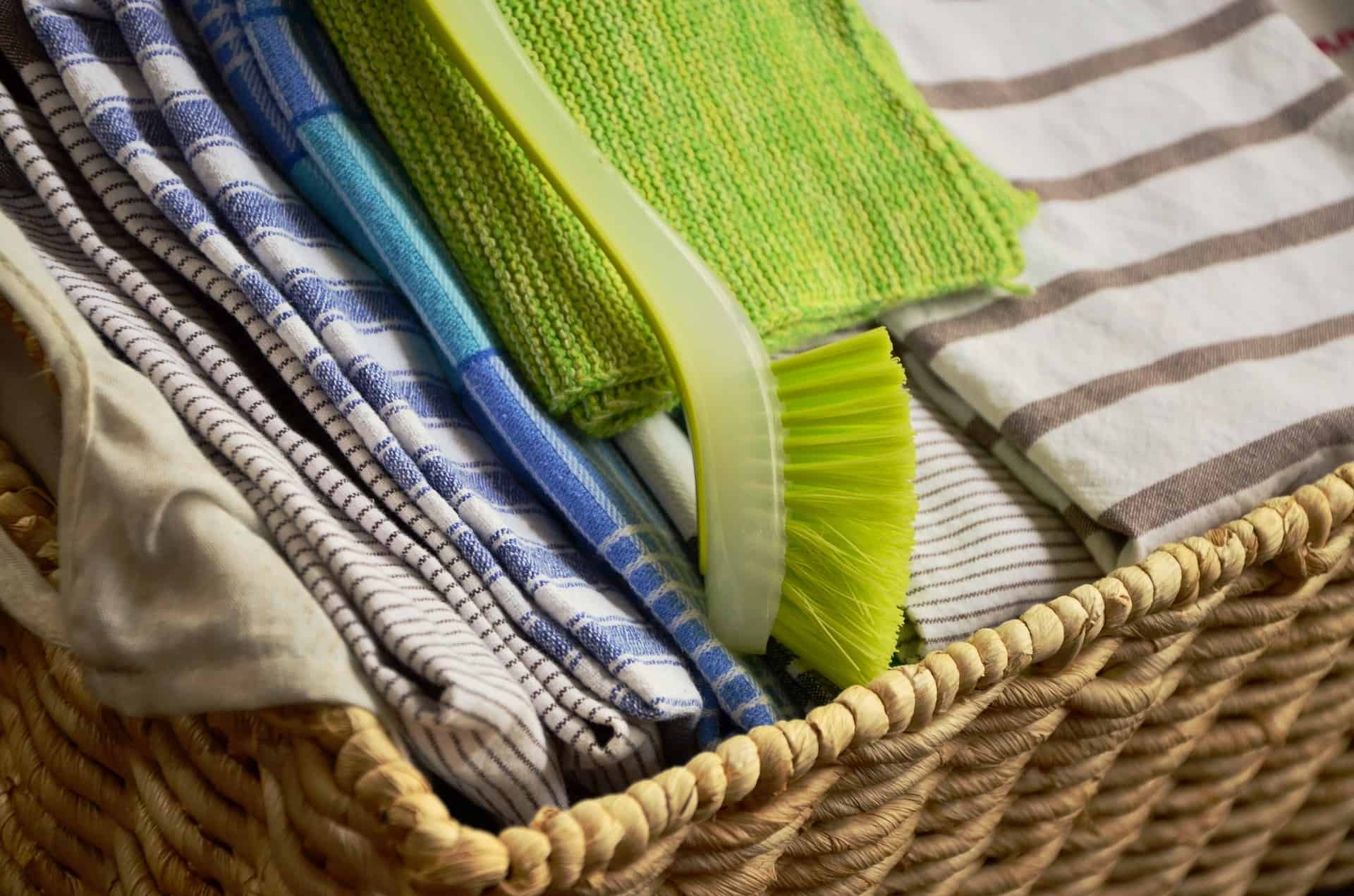 wicker basket full of folded up towels