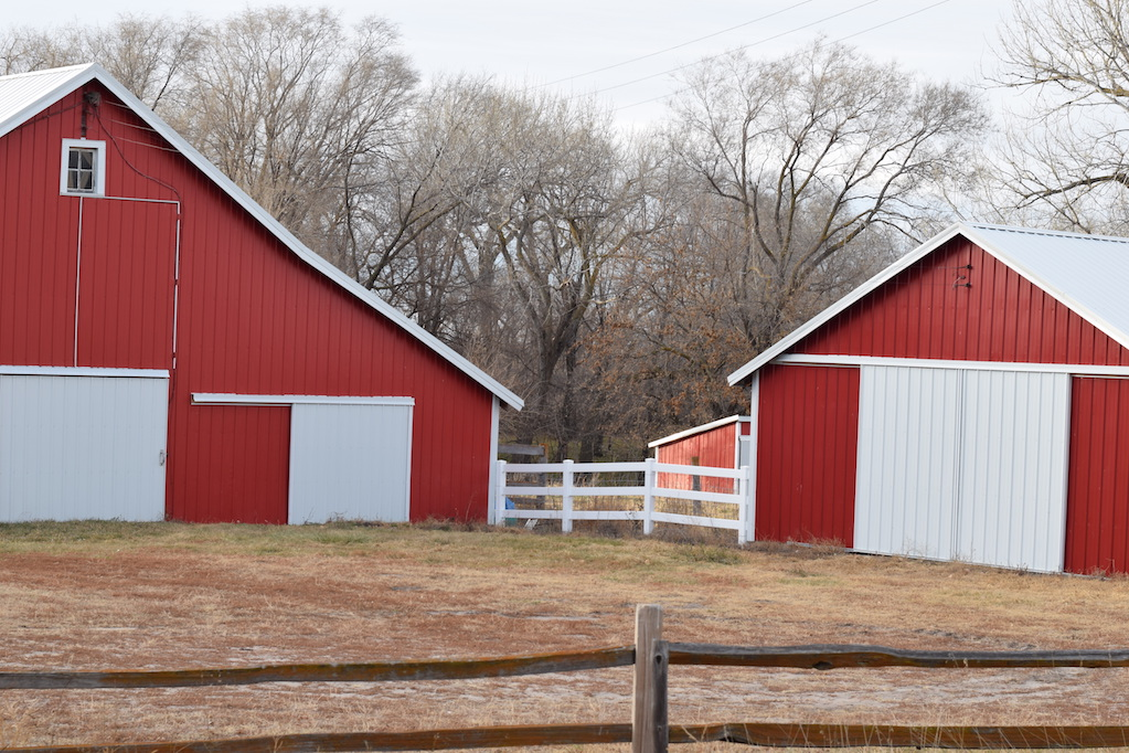 two red barns on a farm