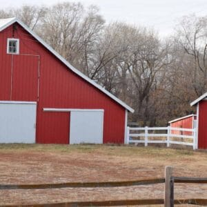 red barn with white doors
