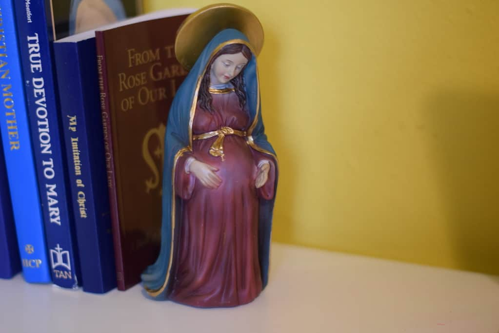 Blessed Mother statue displayed on a desk