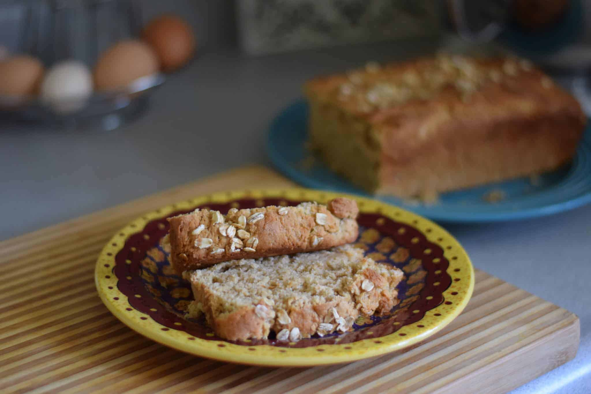 fresh baked bread loaf and slices of bread on a plate