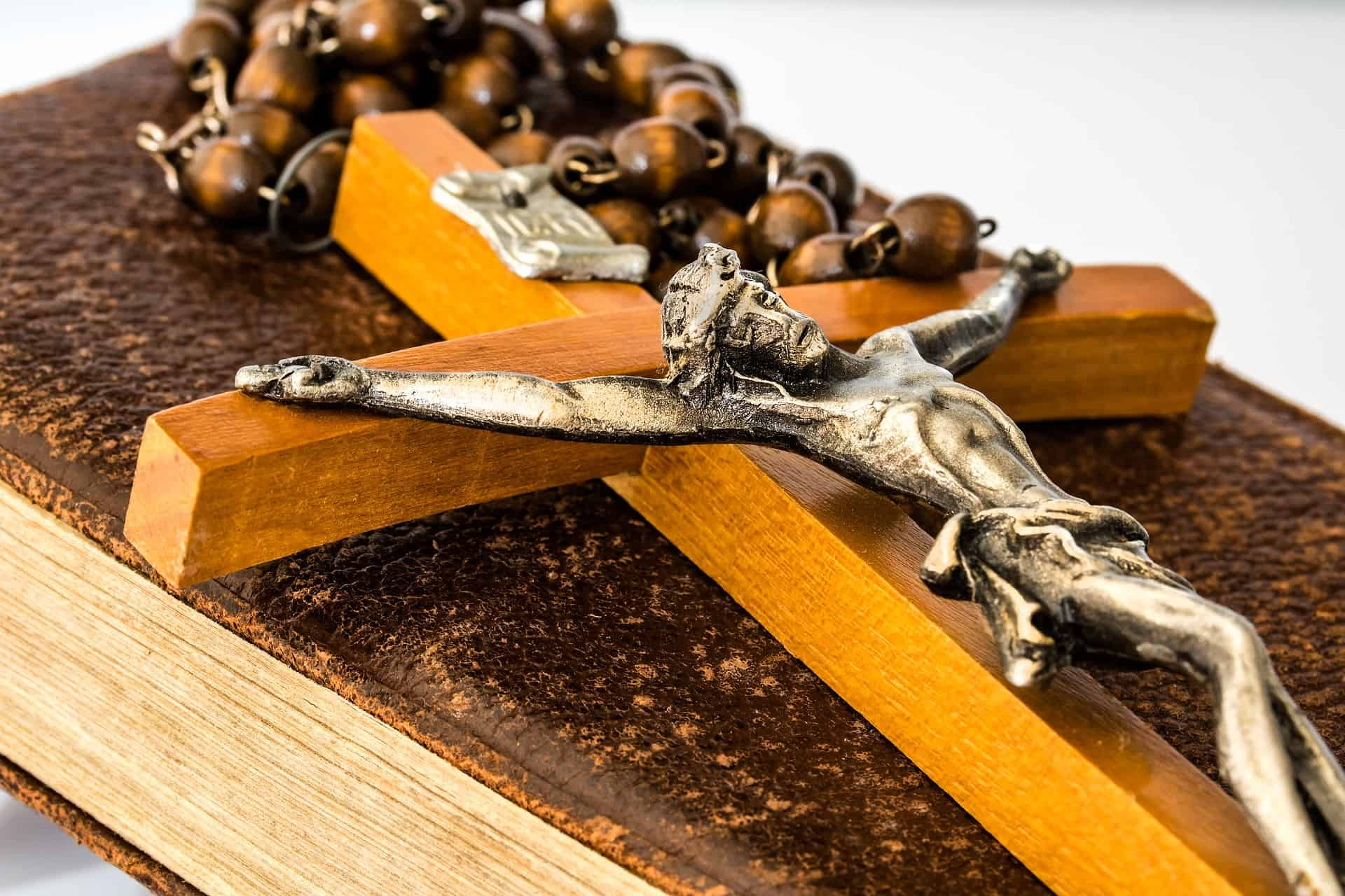 large crucifix on a rosary and prayer book