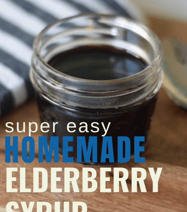 homemade elderberry syrup in a small glass mason jar