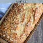 honey oat loaf bread in a stoneware bread pan