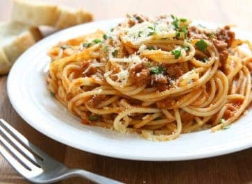 white plate of pasta with Italian pasta sauce and meat
