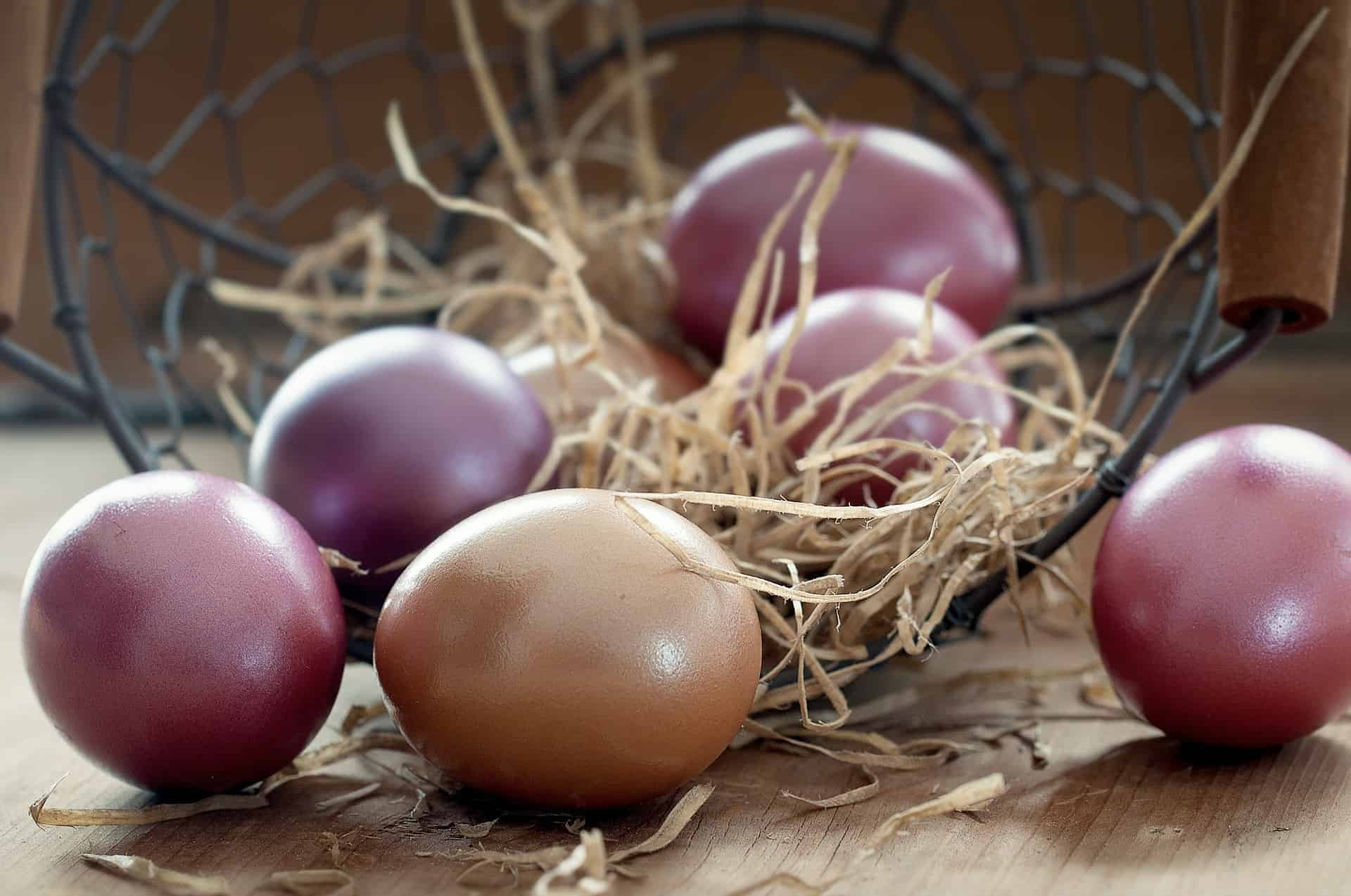 dyed Easter eggs in a black basket