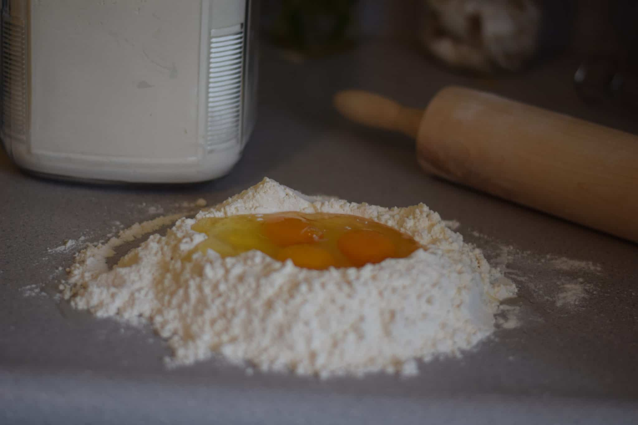 flour and eggs on a counter top
