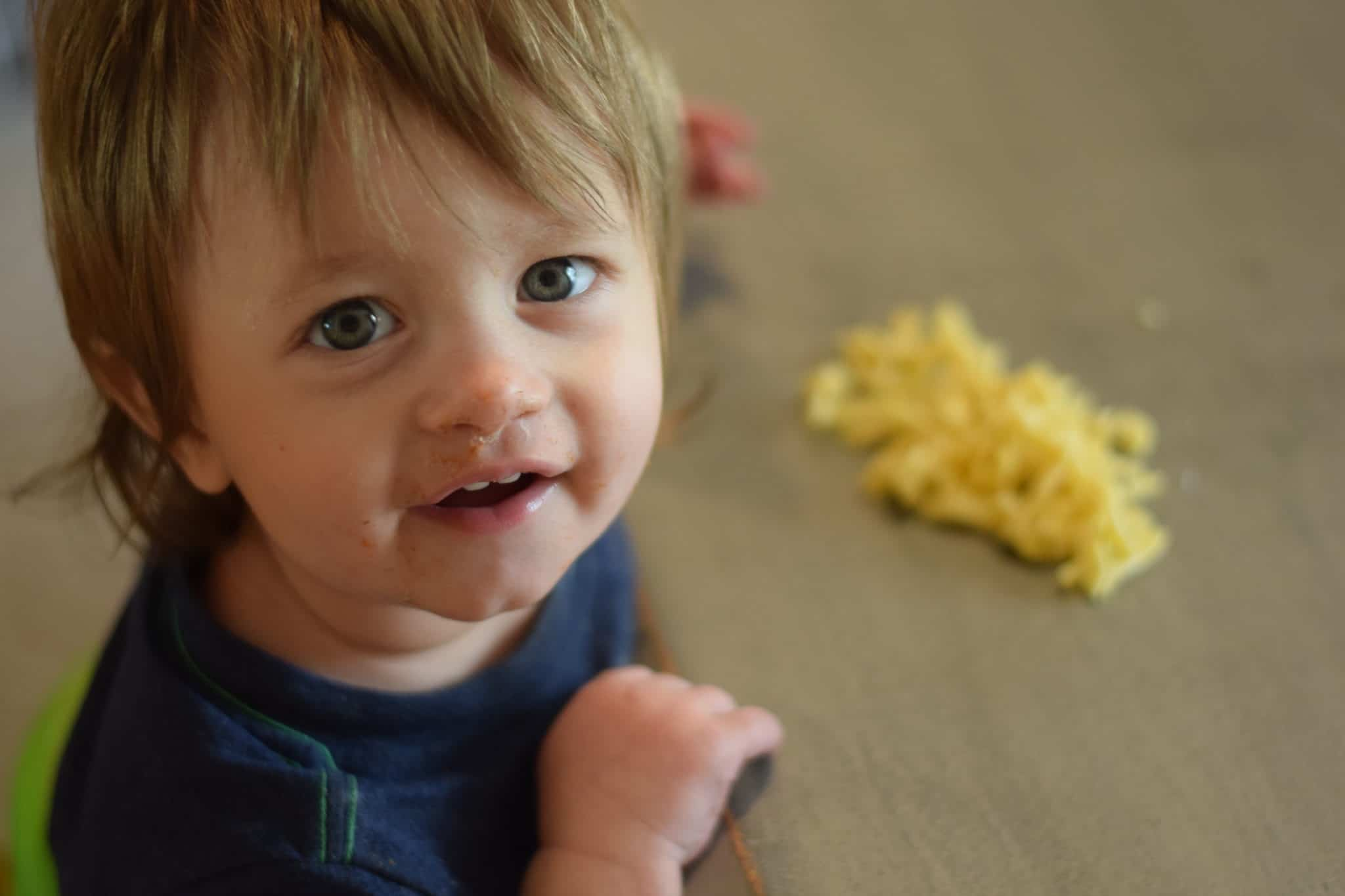 little boy eating fresh cooked pasta