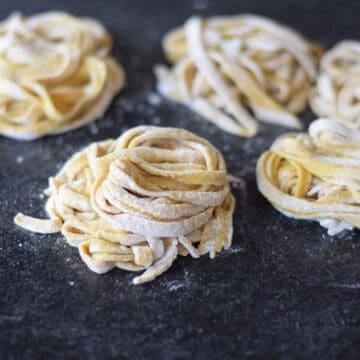homemade pasta noodles on a black countertop