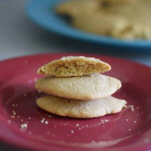 stack of 3 honey butter cookies on a red plate