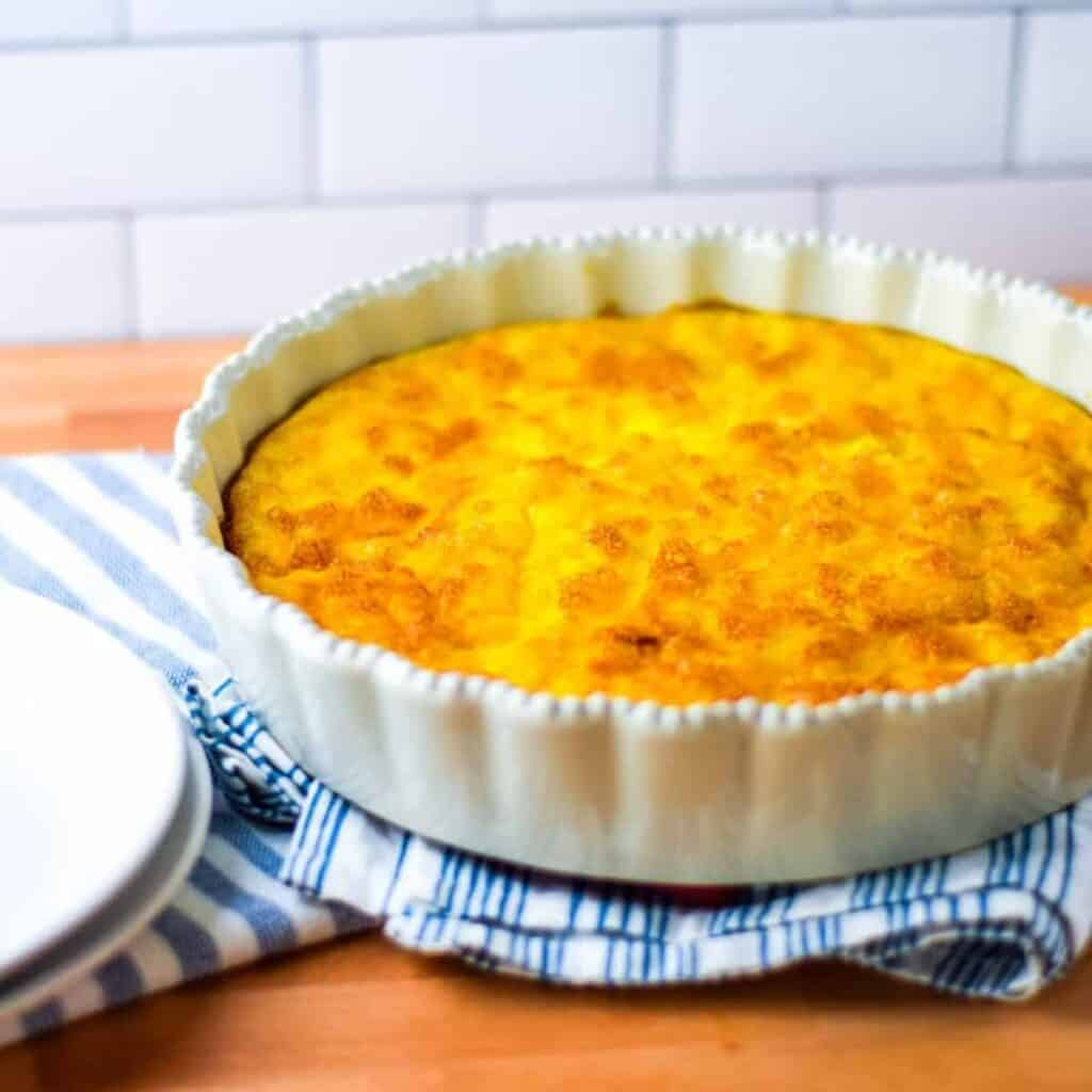 finished quiche in a white pie dish