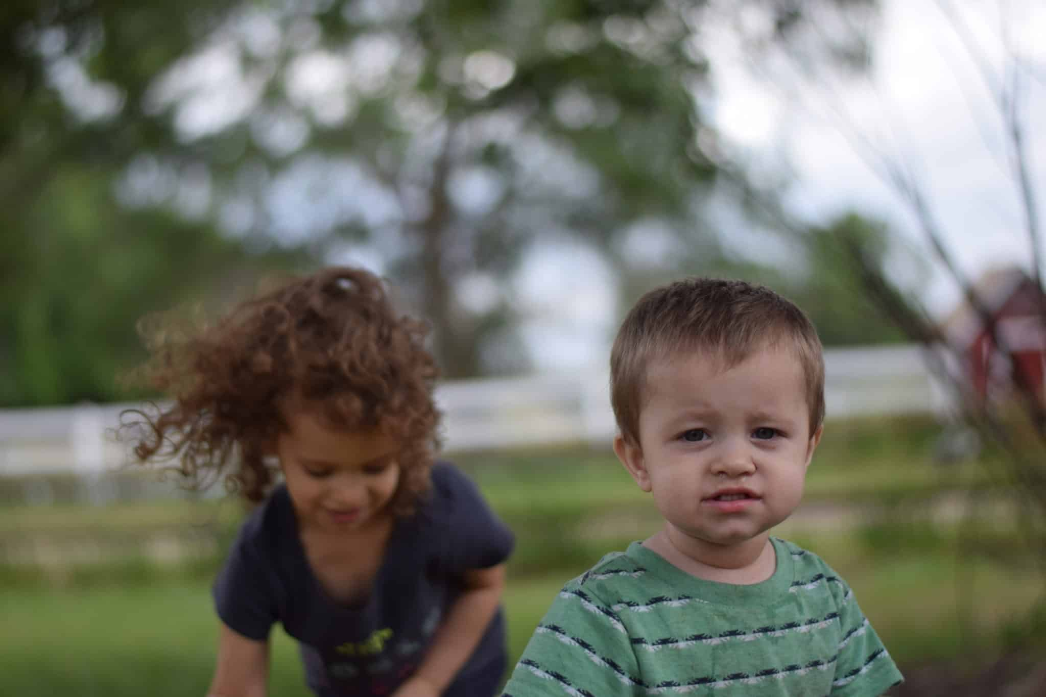 little boy and girl playing outdoors