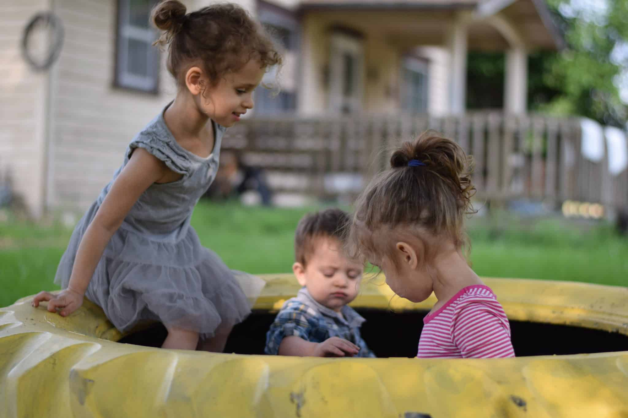little children playing in a sandbox