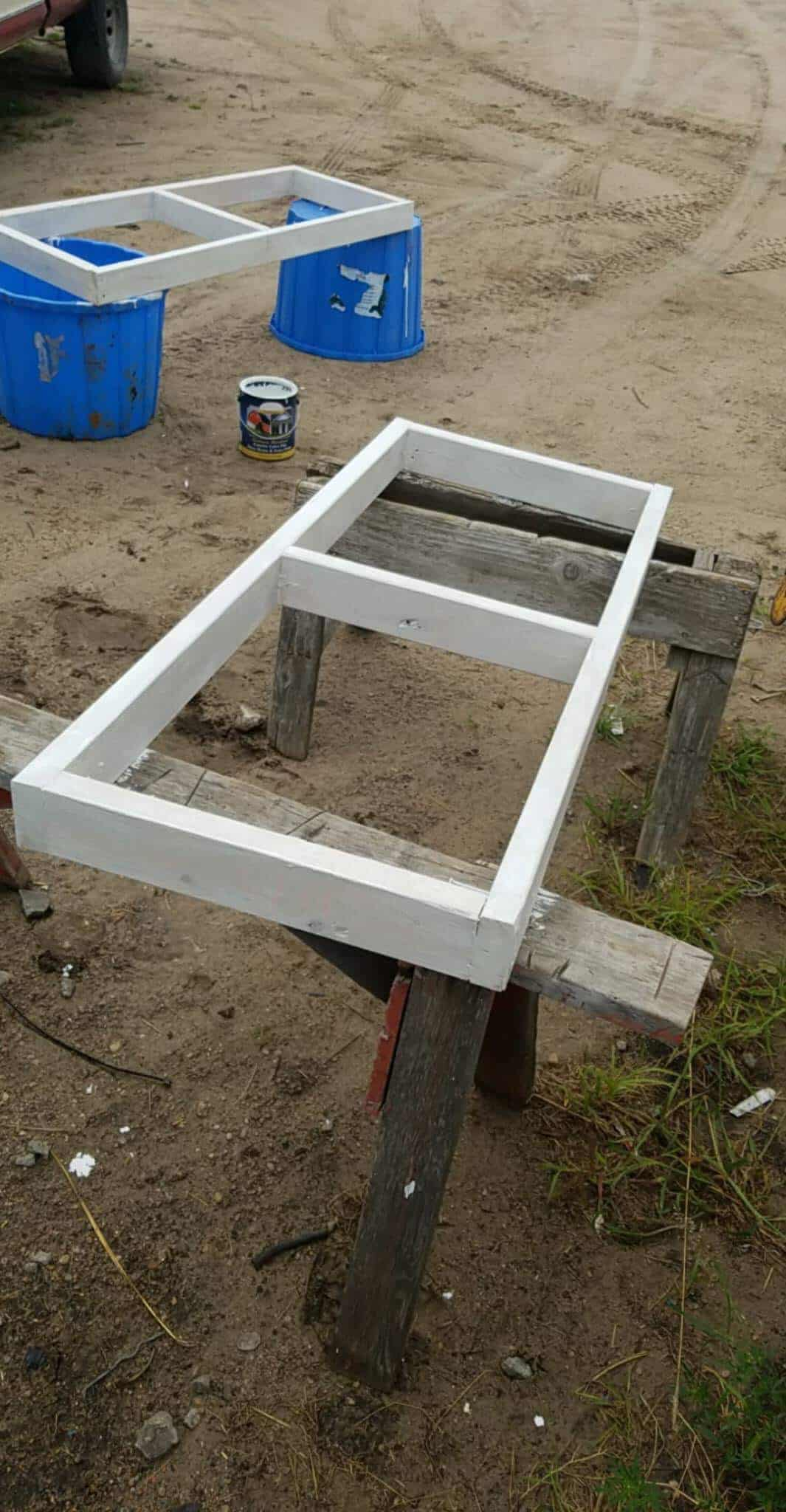 Two of the vents being built and painted white, being displayed outside before being installed in the greenhouse.