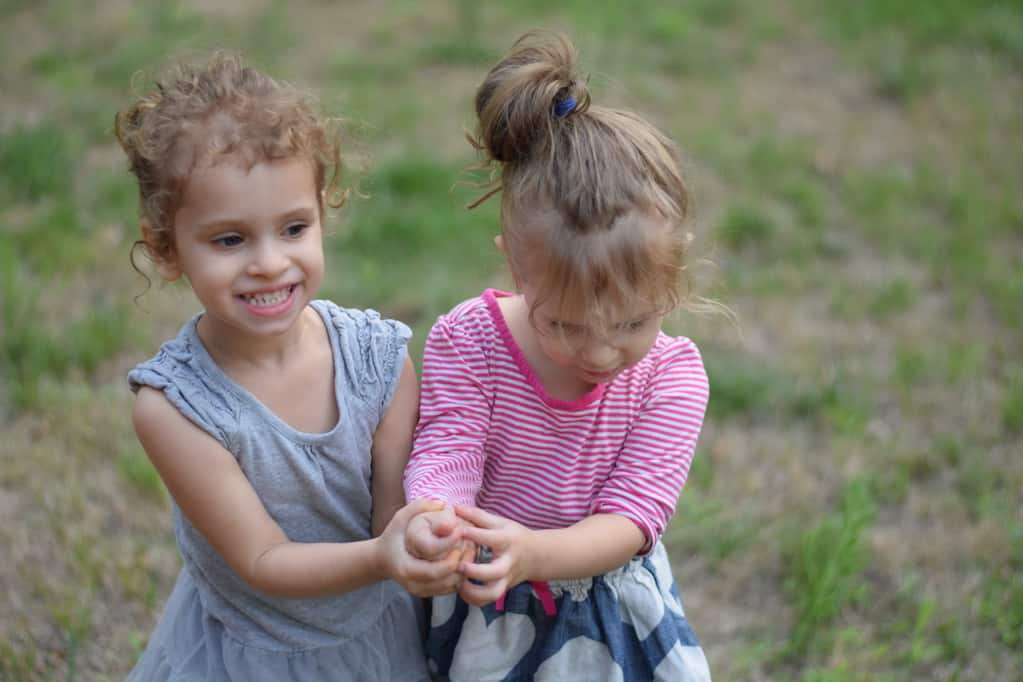 two little girls playing outside