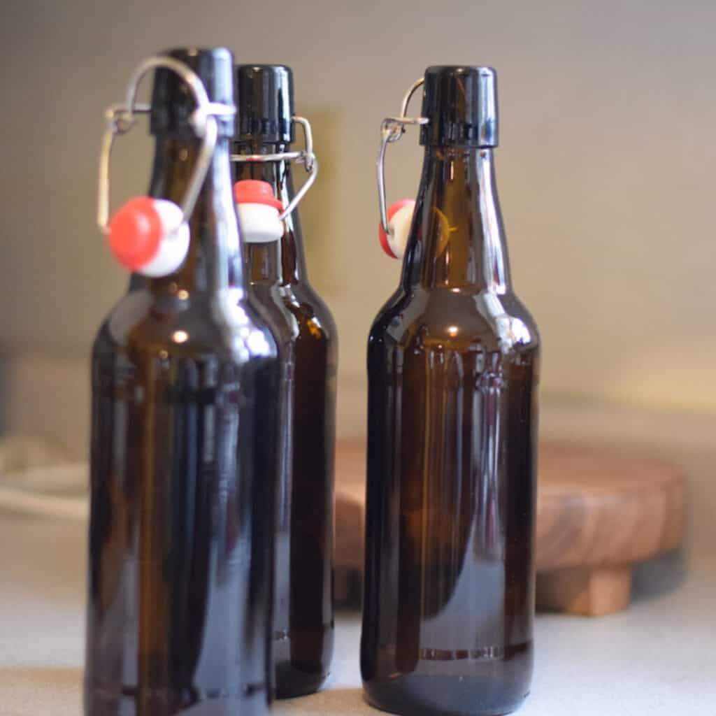 brown flip top glass bottles of homemade soda