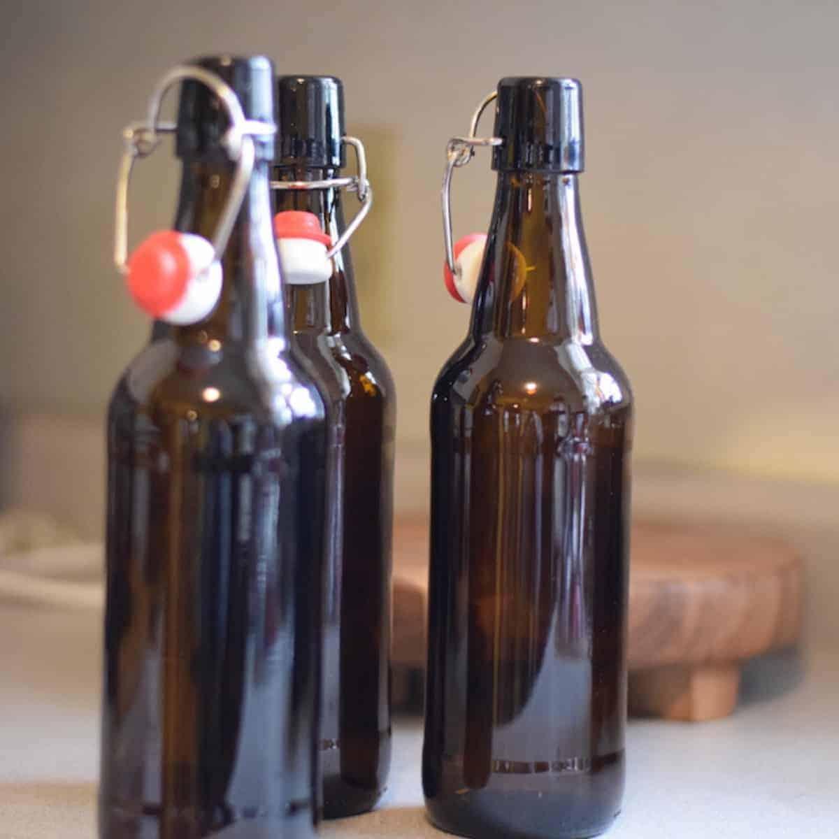 brown flip top glass bottles of homemade soda