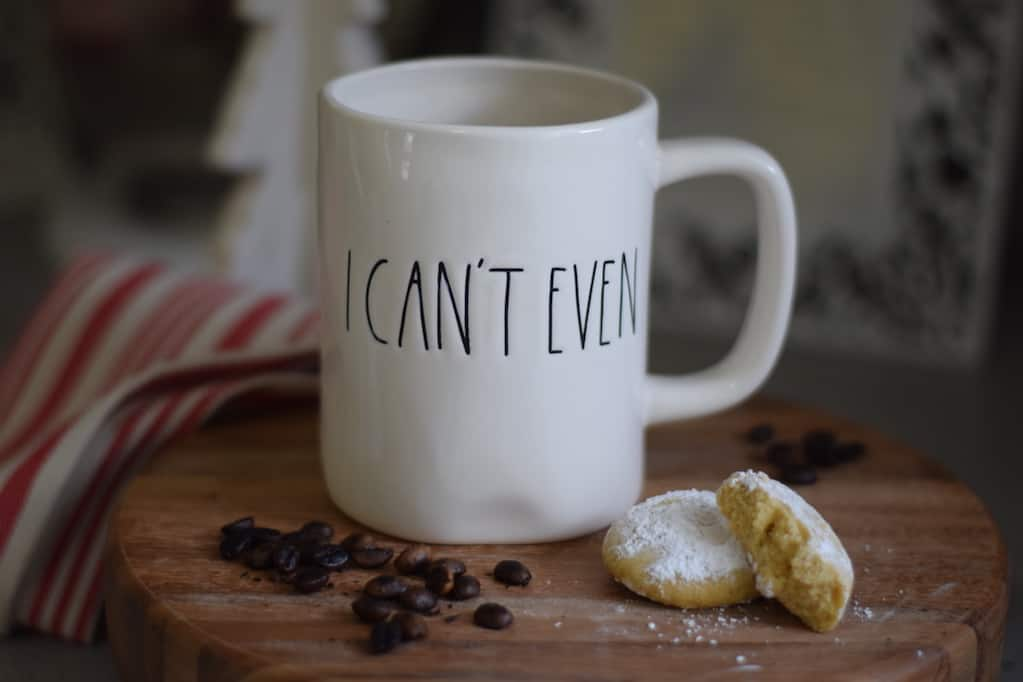 coffee cup with a cookie