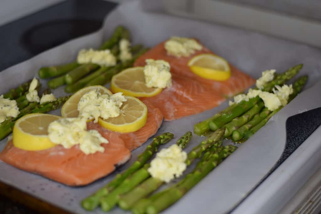 salmon and asparagus on a baking sheet