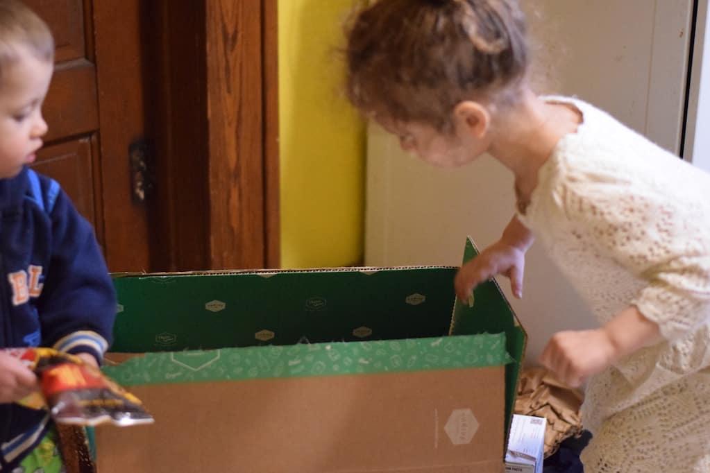 children helping unpack groceries