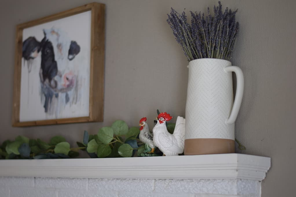 white vase with dried lavenders and chicken figurines
