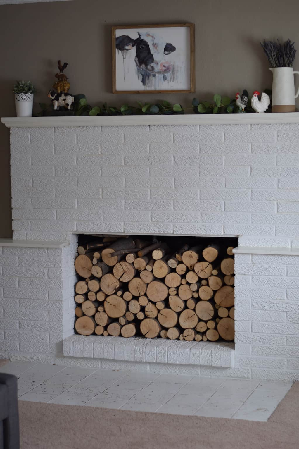 decorated a farmhouse mantle with cut wood