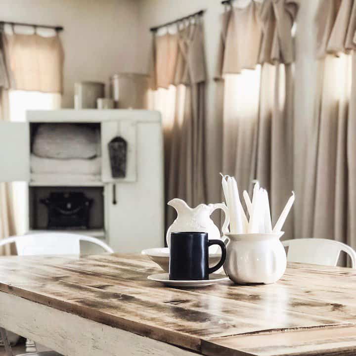 DIY farmhouse curtains hanging in the dining room
