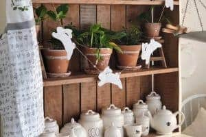 terra cotta pots displayed on rustic farmhouse shelving