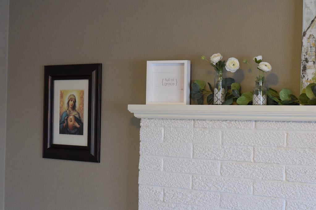 full of grace wood decor on spring farmhouse mantel