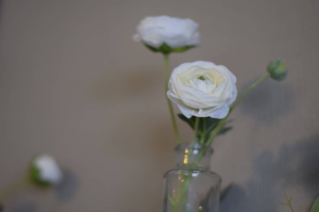 white florals in mini vases Decor for a Farmhouse Spring Mantel