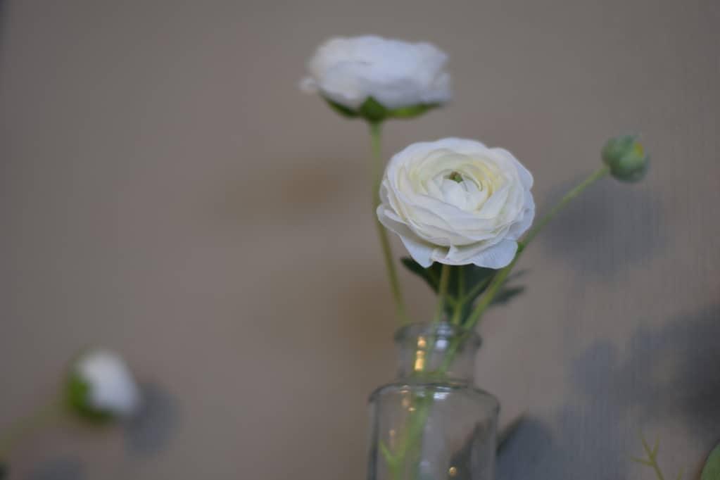 white florals in mini vases Decor for a Farmhouse Spring Mantel