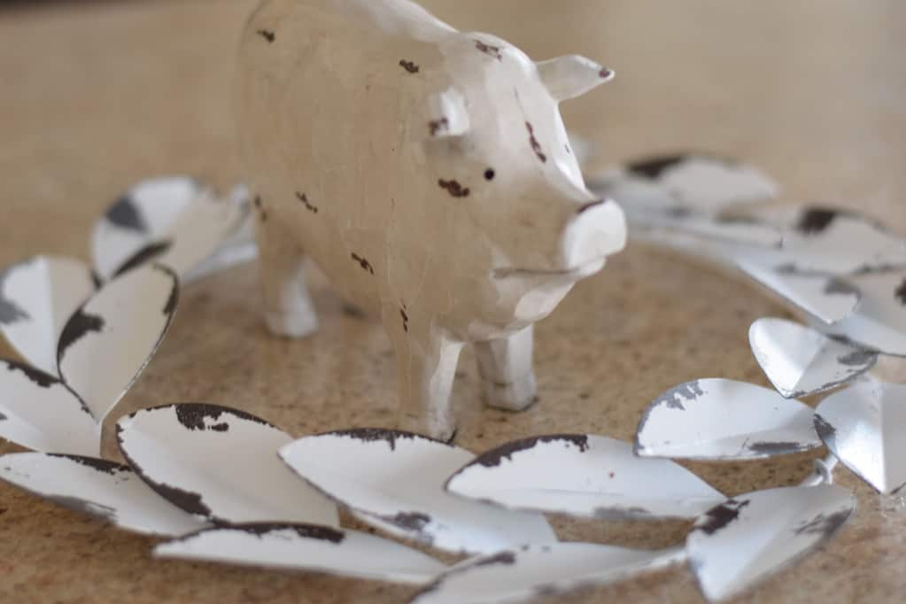 spring pig in a white wreath for a spring mantel decor