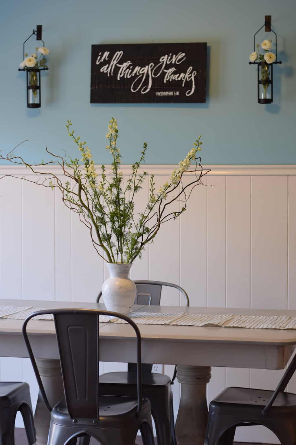 farmhouse dining room table with willow branches and spring decor