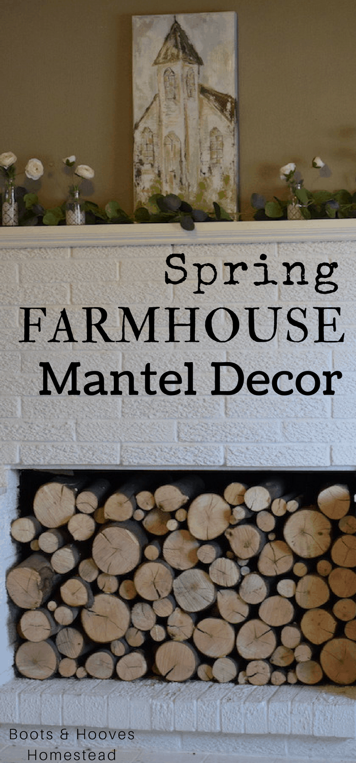 farmhouse style white fireplace mantel with painting of a country church displayed on top