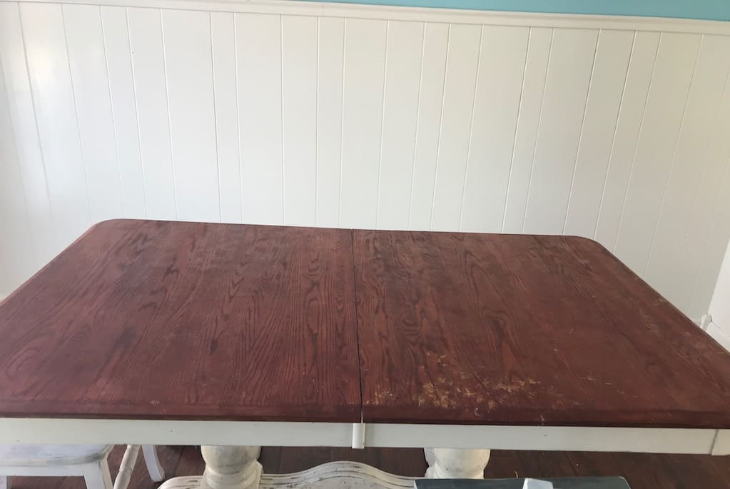 farmhouse dining room table before repainting it.
