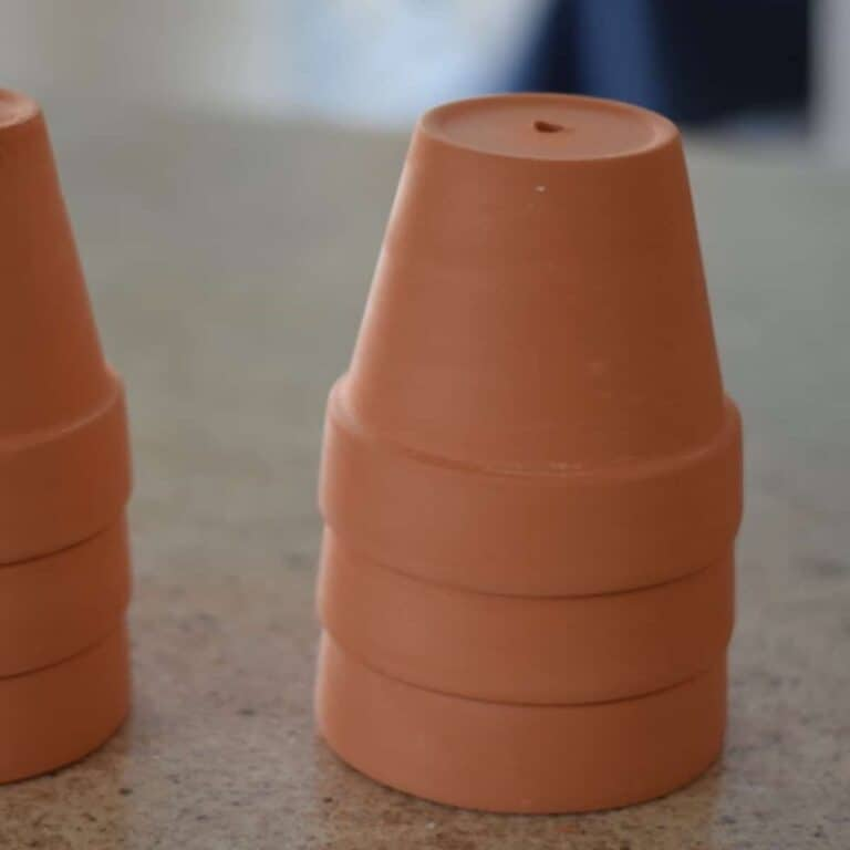 stack of terra cotta pots on counter