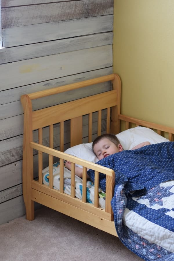 toddler boy sleeping in bed