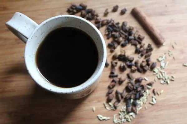Dandelion root coffee in a mug on a wooden table