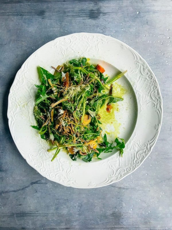 Dandelion Salad on white plate