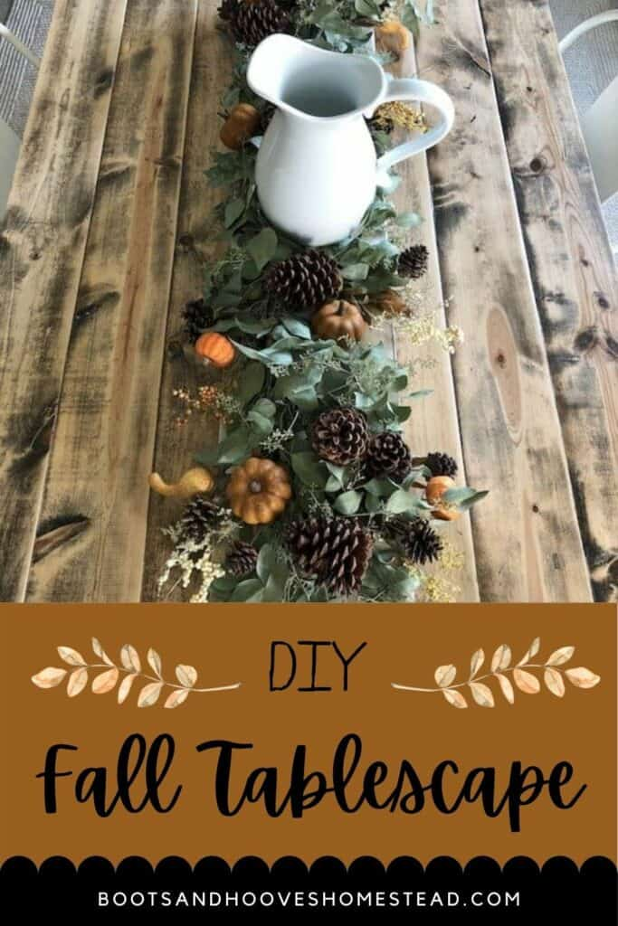 fall tablescape setting on a wooden dinner table