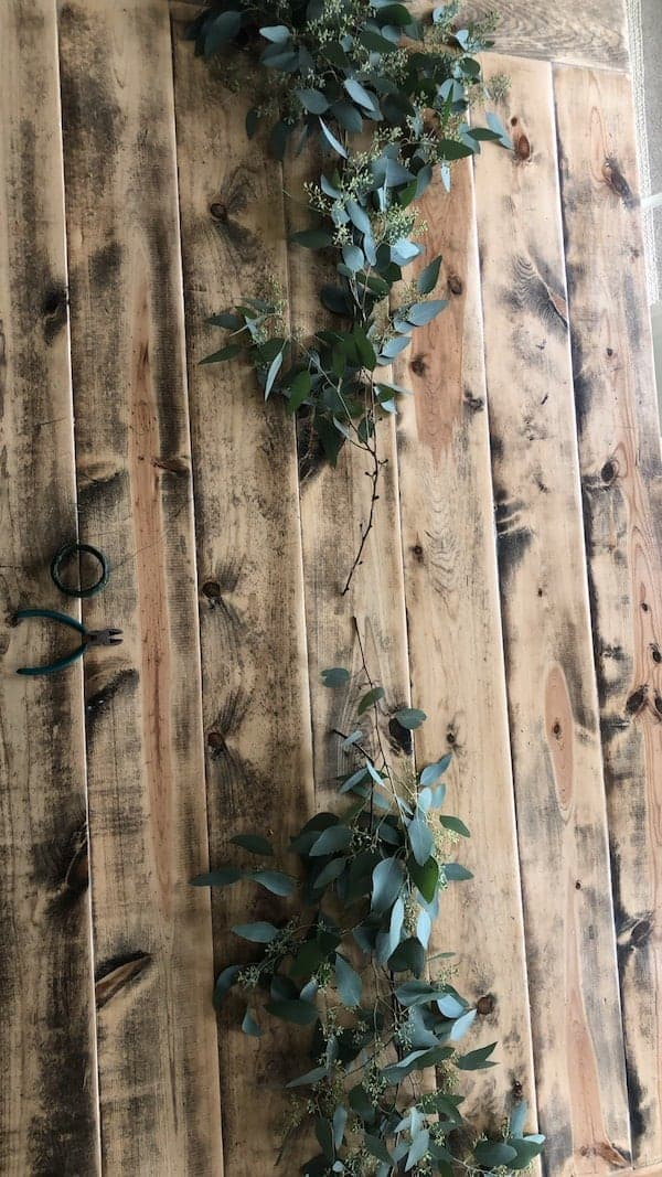eucalyptus greenery at edge of length of table