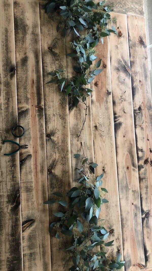 eucalyptus greenery at edge of length of table