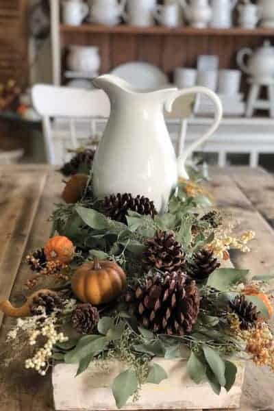 Completed fall tablescape with a white farmhouse pitcher added to the center