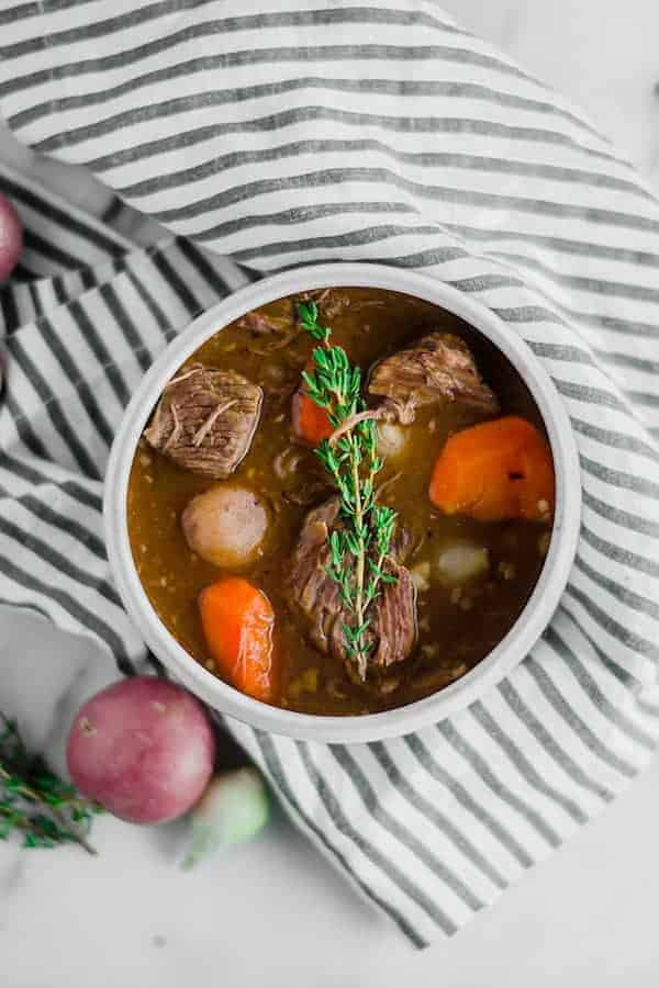 Birdseye view of beef stew in a white bowl