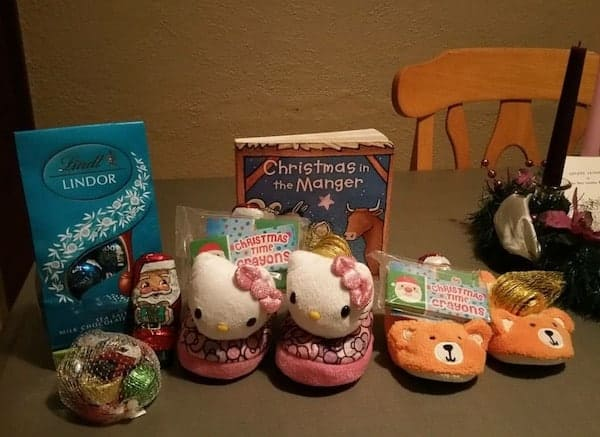 children's slippers filled with small chocolate candies for st Nicholas day