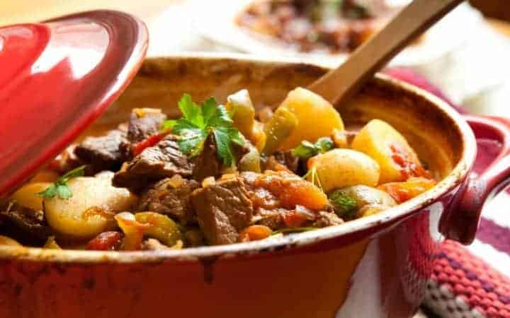 stew in a red dutch oven an ultimate fall comfort foods