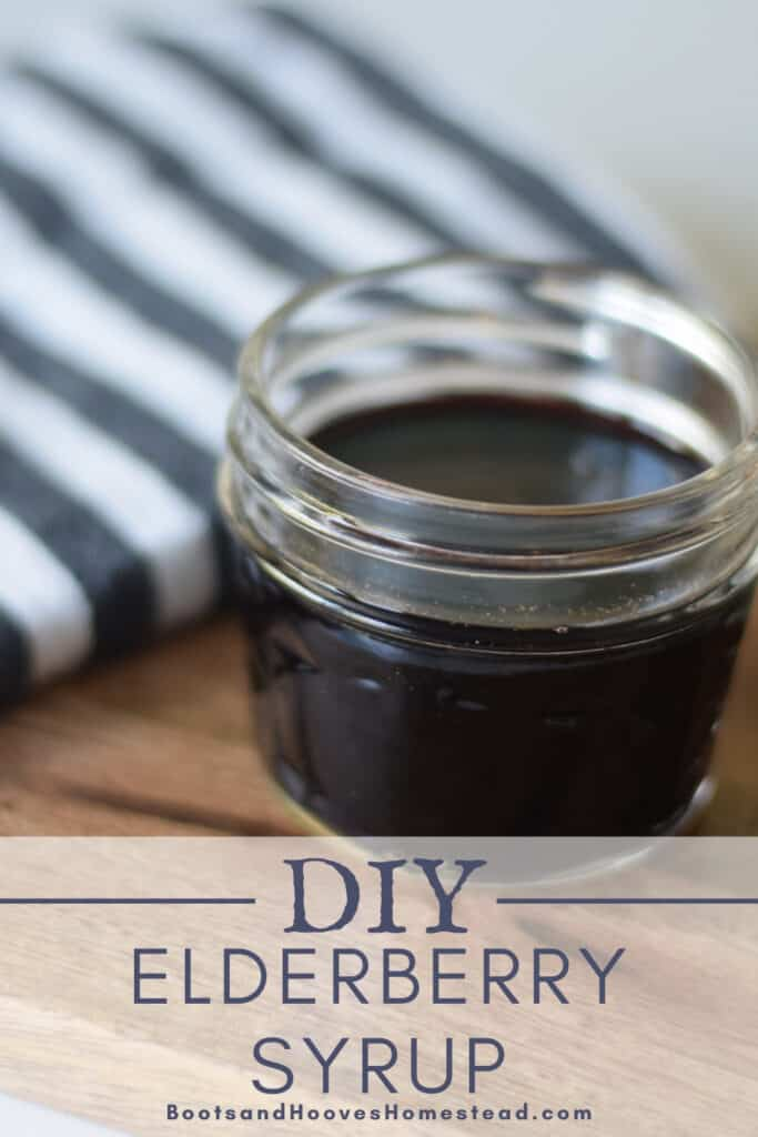 small mason jar of homemade elderberry syrup